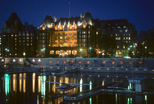 Empress Hotel at night, circa 1976 The Empress Hotel on the waterfront in Victoria, British Columbia. hearkencreative stock pictures, royalty-free photos & images