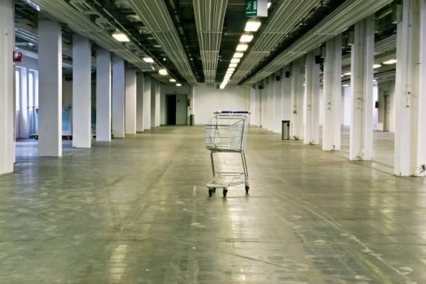 Empty Abandoned Warehouse with Shopping Cart stock photo