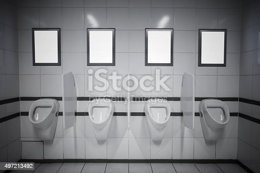 istock Empty advertisement frames in public toilet 497213492