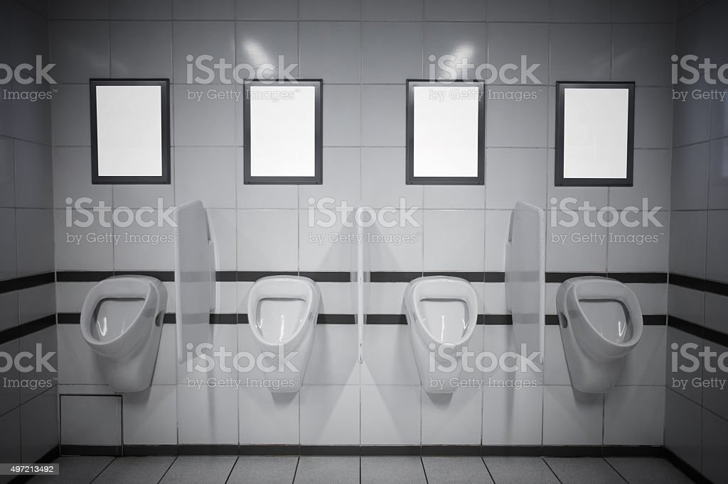 Empty advertisement frames in public toilet stock photo