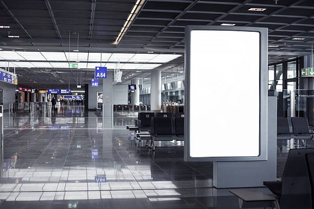 empty advertising frame in airport - airport terminal stock photos and pictures