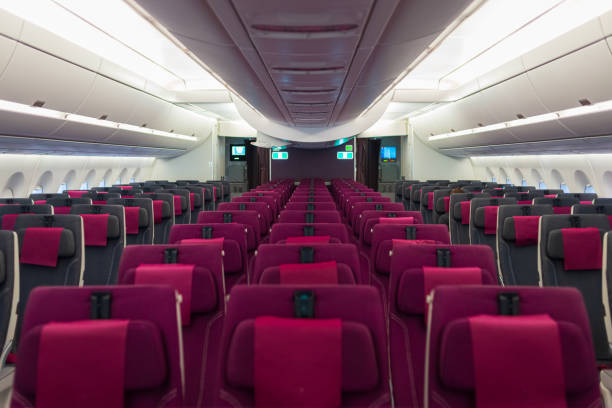 Empty aircraft cabin interior due to covid-19 medical global emergency pandemy. Transportation lockdown airline company economy default. No passenger on commercial plane. stock photo