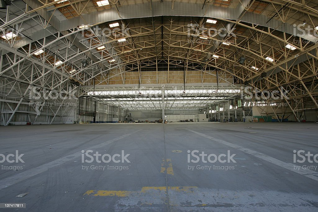 Empty airplane hanger with lights on stock photo