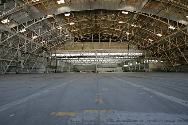 https://media.istockphoto.com/photos/empty-airplane-hanger-with-lights-on-picture-id137417811?k=6&m=137417811&s=612x612&w=0&h=_Fg0YhU9VKd2YpcLrMFQ6KC1Z-2Gk73cWnQ9-EGkEtY=