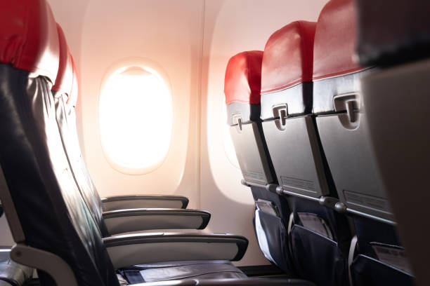 Empty airplane seats and window.Passenger seats in economy class.airplane interior stock photo