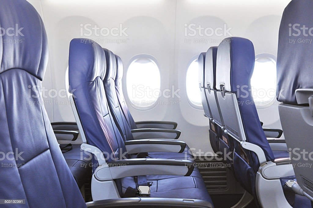 Empty airplane seats stock photo