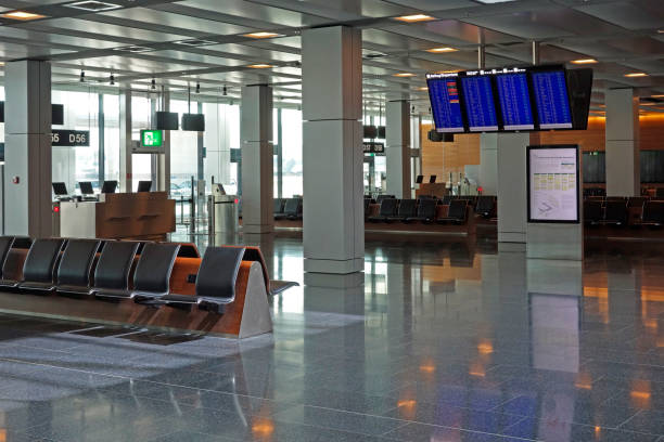 Empty airport departure lounge waiting area with flight informat stock photo