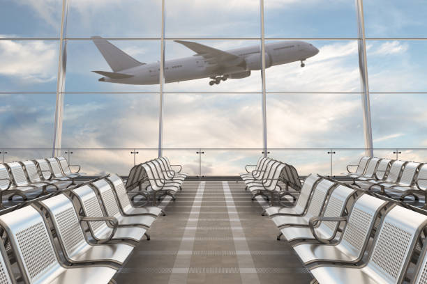 empty airport departure lounge with airplane - airport stock photos and pictures