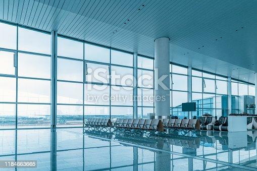 istock Empty airport terminal waiting area 1184663665