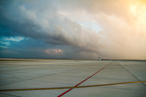 Empty airport with awesome sky impressive sky scene at the airport runway. airfield stock pictures, royalty-free photos & images