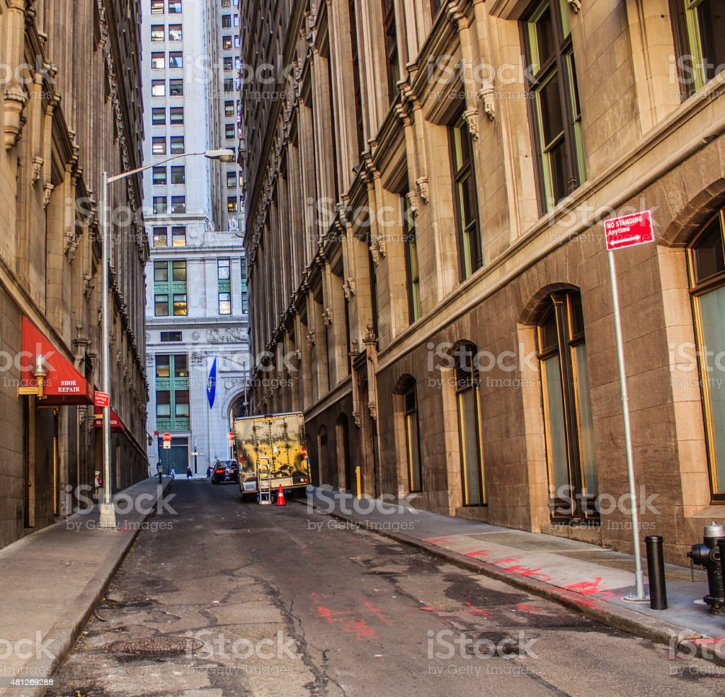 Empty alley  with a truck parked stock photo