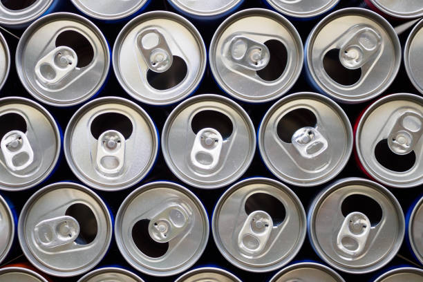 empty aluminium drink cans recycling background concept - alluminio foto e immagini stock