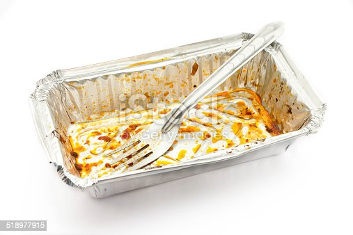 istock Empty aluminium foil tray after eat on a white background 518977915