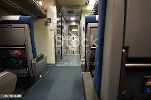 Looking down the aisle of an empty Amtrak train car on the Hiawatha Service Line en route from Chicago to Milwaukee in late December.