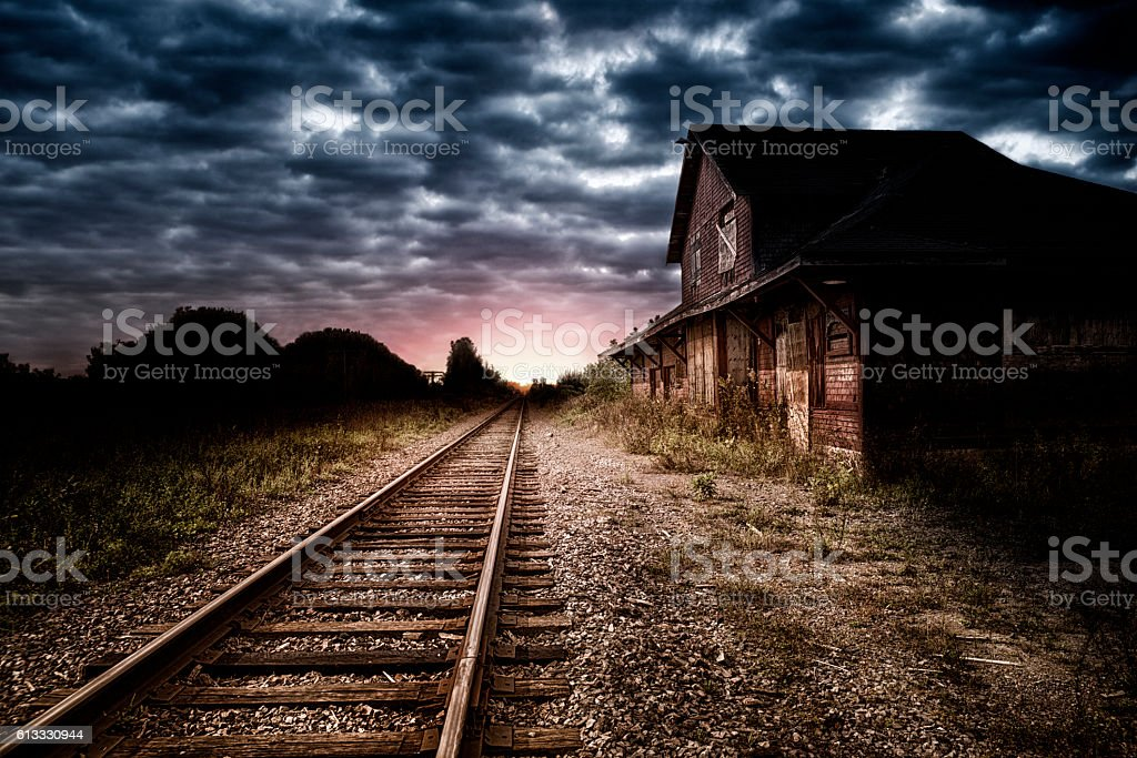 Empty and abandoned train station at night stock photo