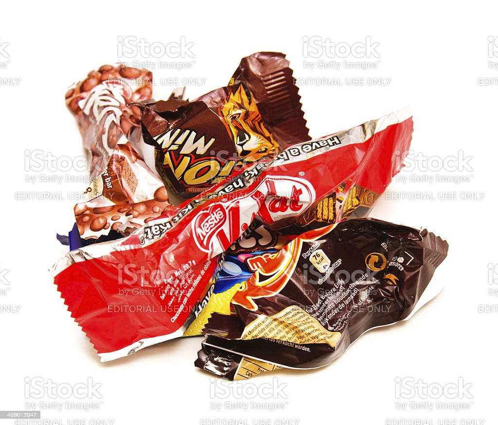 Empty and crumpled candy bars royalty-free stock photo