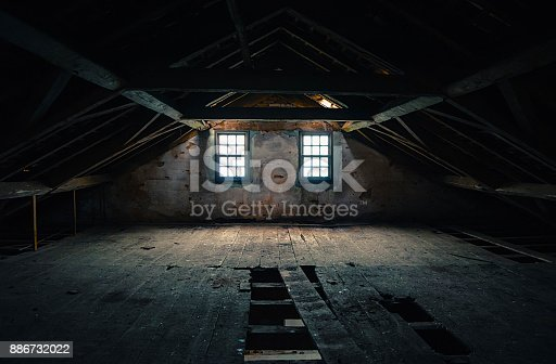 istock Empty and haunted attic 886732022