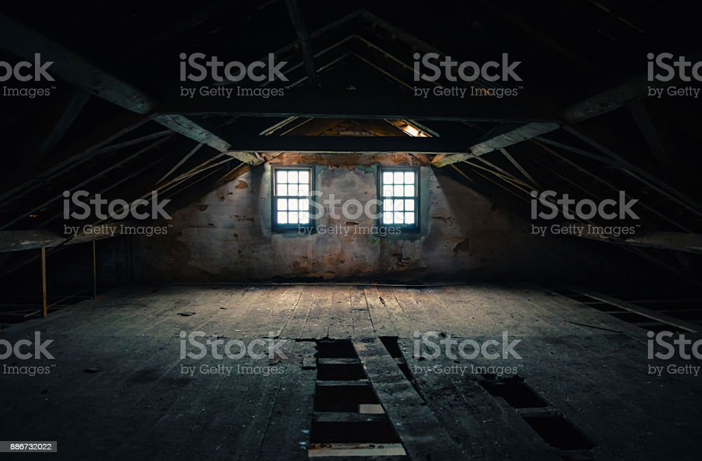 Empty and haunted attic stock photo