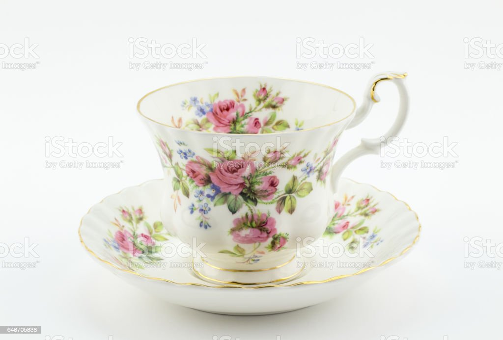 Empty antique cup and saucer with rose decoration isolated on white - English tea stock photo