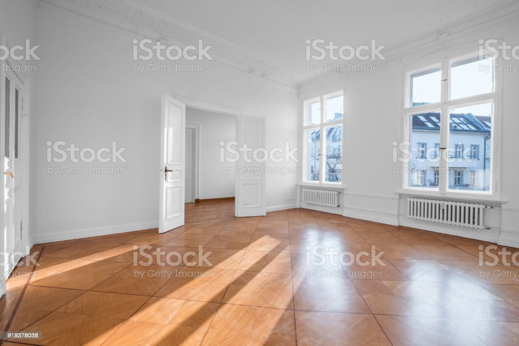 empty apartment room - flat for rent with wooden floor stock photo