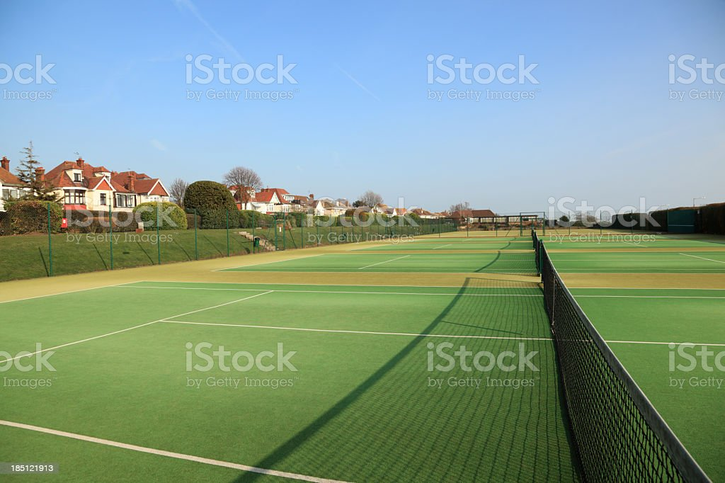 empty artificial grass tennis courts sunny day essex england stock photo