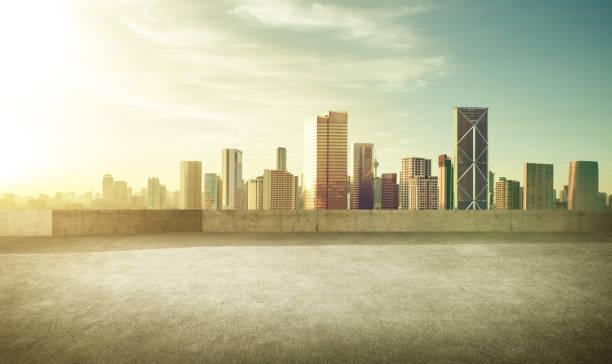 Empty asphalt carpark with modern city skyline stock photo