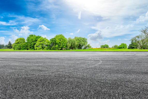 Cтоковое фото Empty asphalt race track ground and green forest in summer