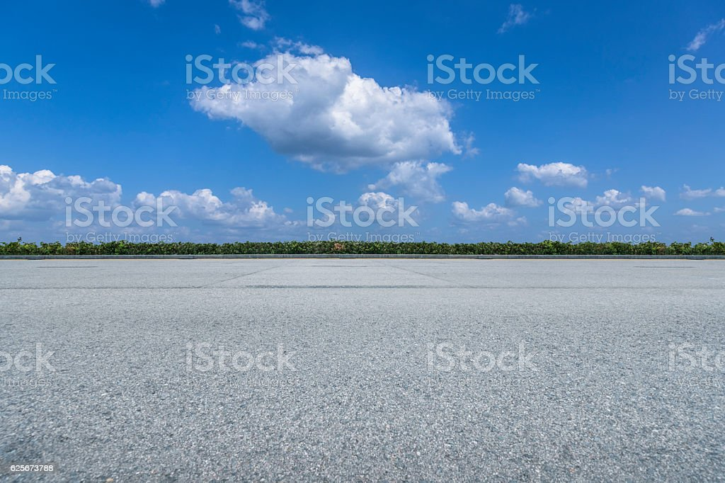 empty asphalt road against blue sky stock photo