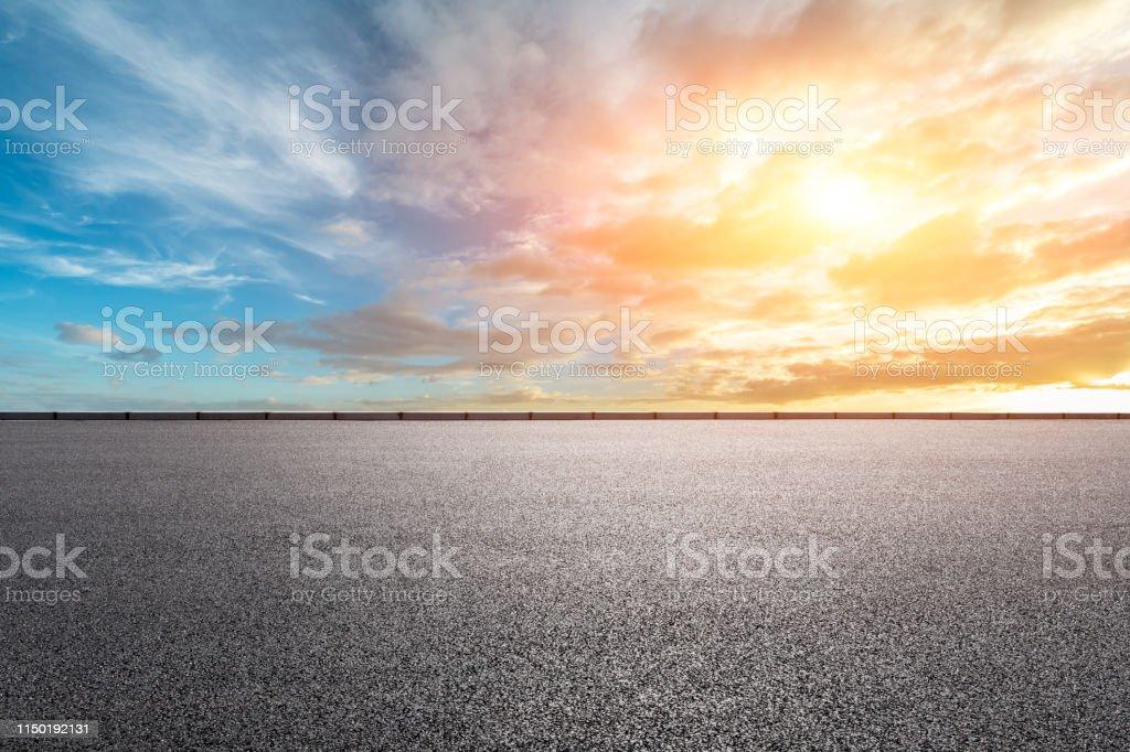 Empty asphalt road and beautiful sky landscape at sunrise