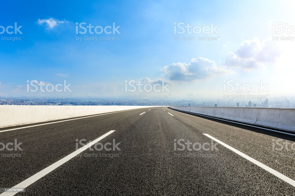 Empty asphalt road and modern city skyline with buildings in Shanghai stock photo