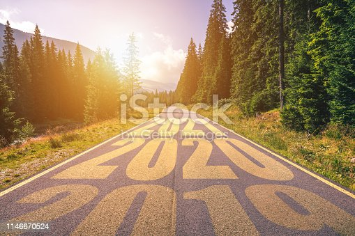 1170070487 istock photo Empty asphalt road and New year 2019, 2020, 2021 concept. Driving on an empty road in the mountains to upcoming 2019, 2020, 2021 and leaving behind old years. Concept for success and passing time. 1146670524