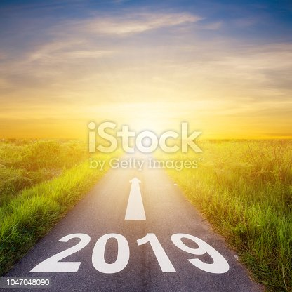 istock Empty asphalt road and New year 2019 concept. Driving on an empty road to Goals 2019. 1047048090