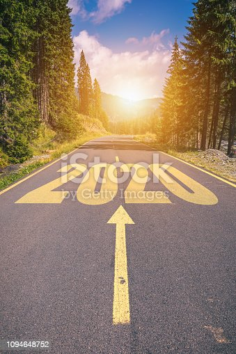 1170070487 istock photo Empty asphalt road and New year 2020 concept. Driving on an empty road in the mountains to upcoming 2020 and leaving behind old 2019. Concept for success and passing time. 1094648752