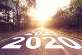 istock Empty asphalt road and New year 2020 concept. Driving on an empty road to Goals 2020. 1153470133