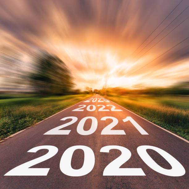 Empty asphalt road and New year 2020 concept. Driving on an empty road to Goals 2020. Empty asphalt road and New year 2020 concept. Driving on an empty road to Goals 2020. forecasting stock pictures, royalty-free photos & images