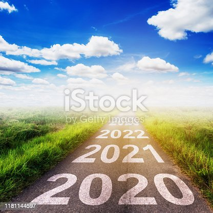 istock Empty asphalt road and New year 2020 concept. Driving on an empty road to Goals 2020. 1181144597