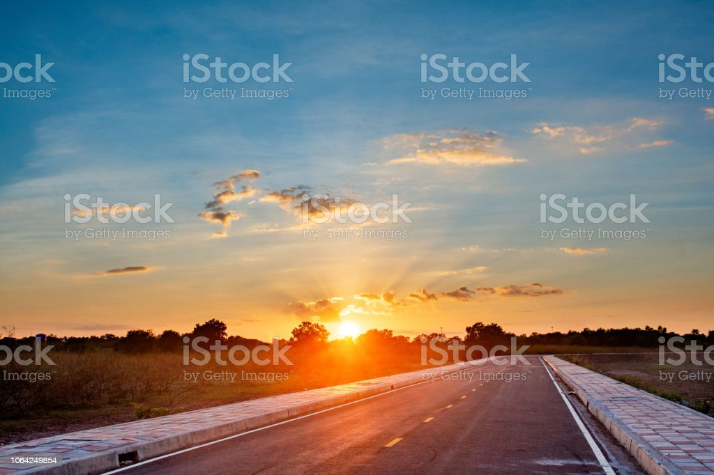 Empty asphalt road blue sky and sunset backgroung with copy space