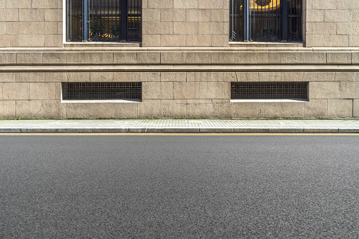 istock empty asphalt road front of the wall 898288080