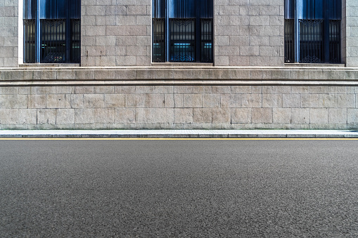 istock empty asphalt road front of the wall 898288212