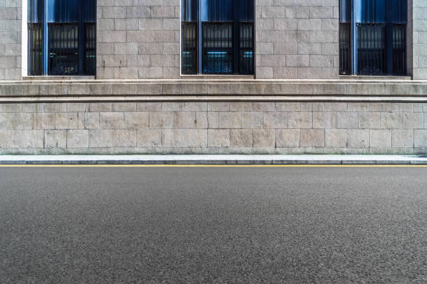 empty asphalt road front of the wall Wall - Building Feature, Street, Brick Wall, Brick, City Street side view stock pictures, royalty-free photos & images
