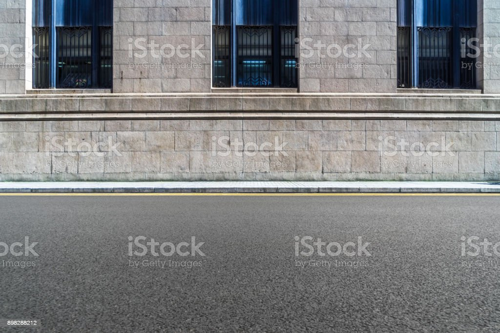 empty asphalt road front of the wall stock photo