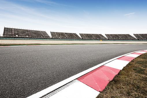 istock empty asphalt road  in car racing track 858476106
