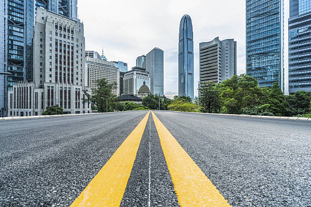 empty asphalt road leading to downtown Hong Kong stock photo