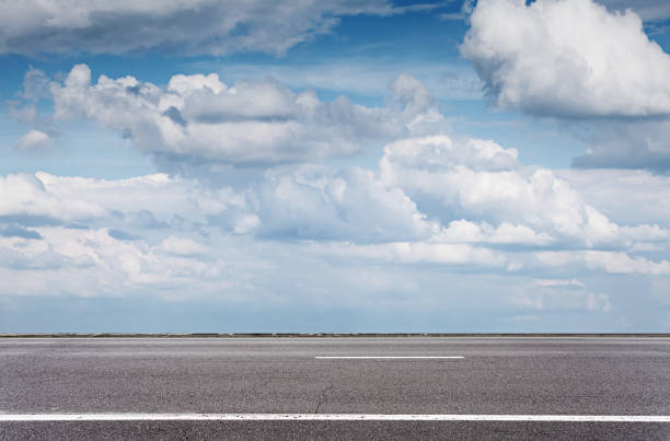Empty asphalt road over blue sky, side view summer day side view stock pictures, royalty-free photos & images