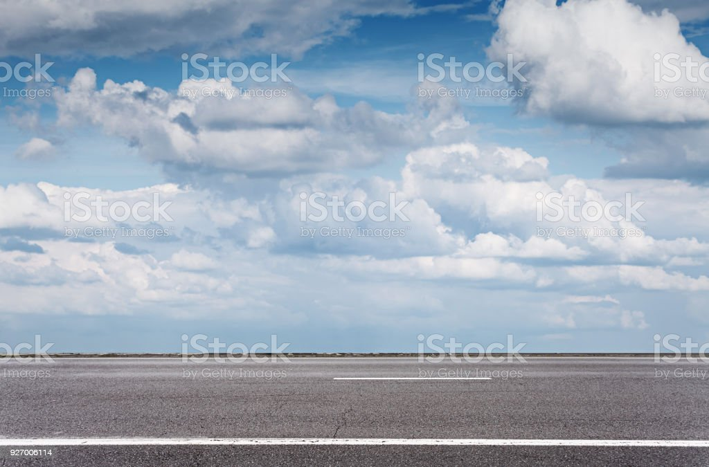 Empty asphalt road over blue sky, side view stock photo