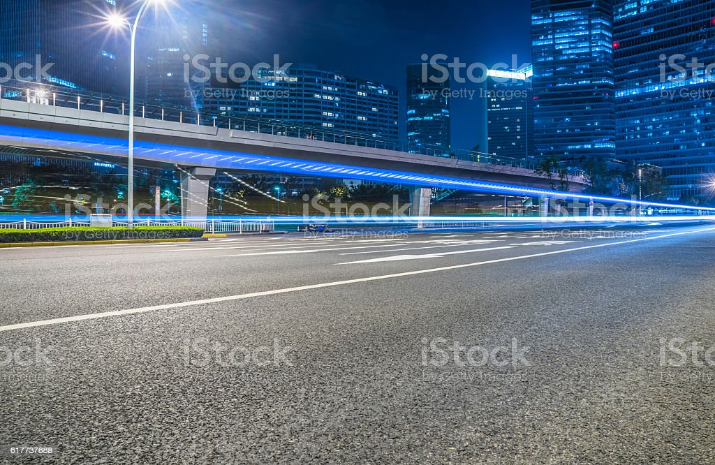 empty asphalt road through modern city. stock photo