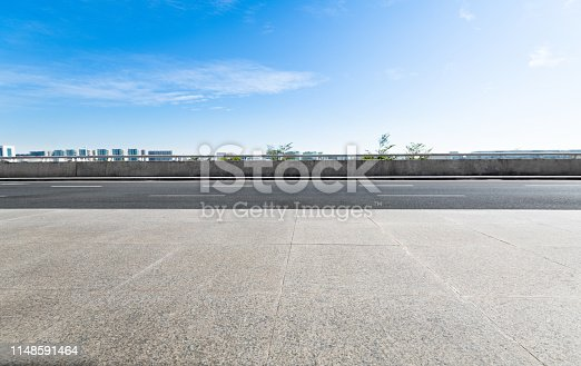 Empty asphalt road with buildings in the city.