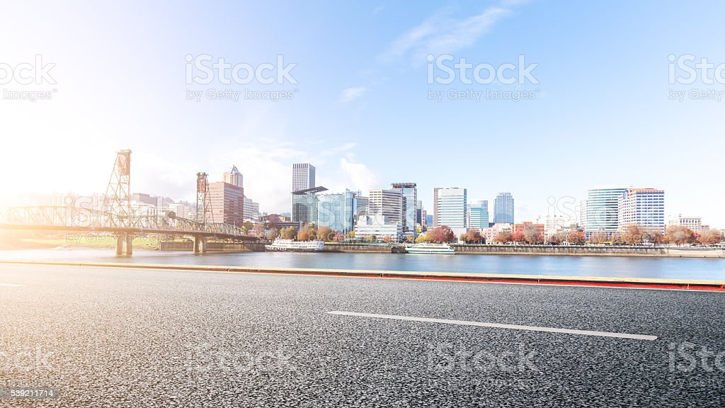 empty asphalt road with cityscape and skyline of portland stock photo