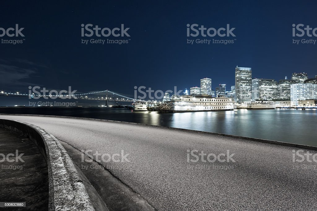 empty asphalt road with cityscape and skyline of san francisco stock photo