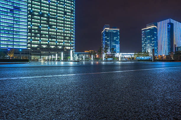 empty asphalt road with cityscape and skyline of Shanghai stock photo
